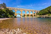 Three-tiered aqueduct Pont du Gard - the highest in Europe. The bridge was built in Roman times on the river Gardon. Provence, spring sunny day poster