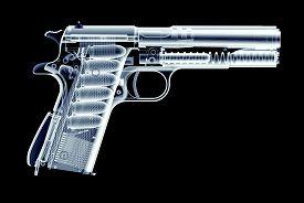 Xray Image Of Gun Isolated On Black
