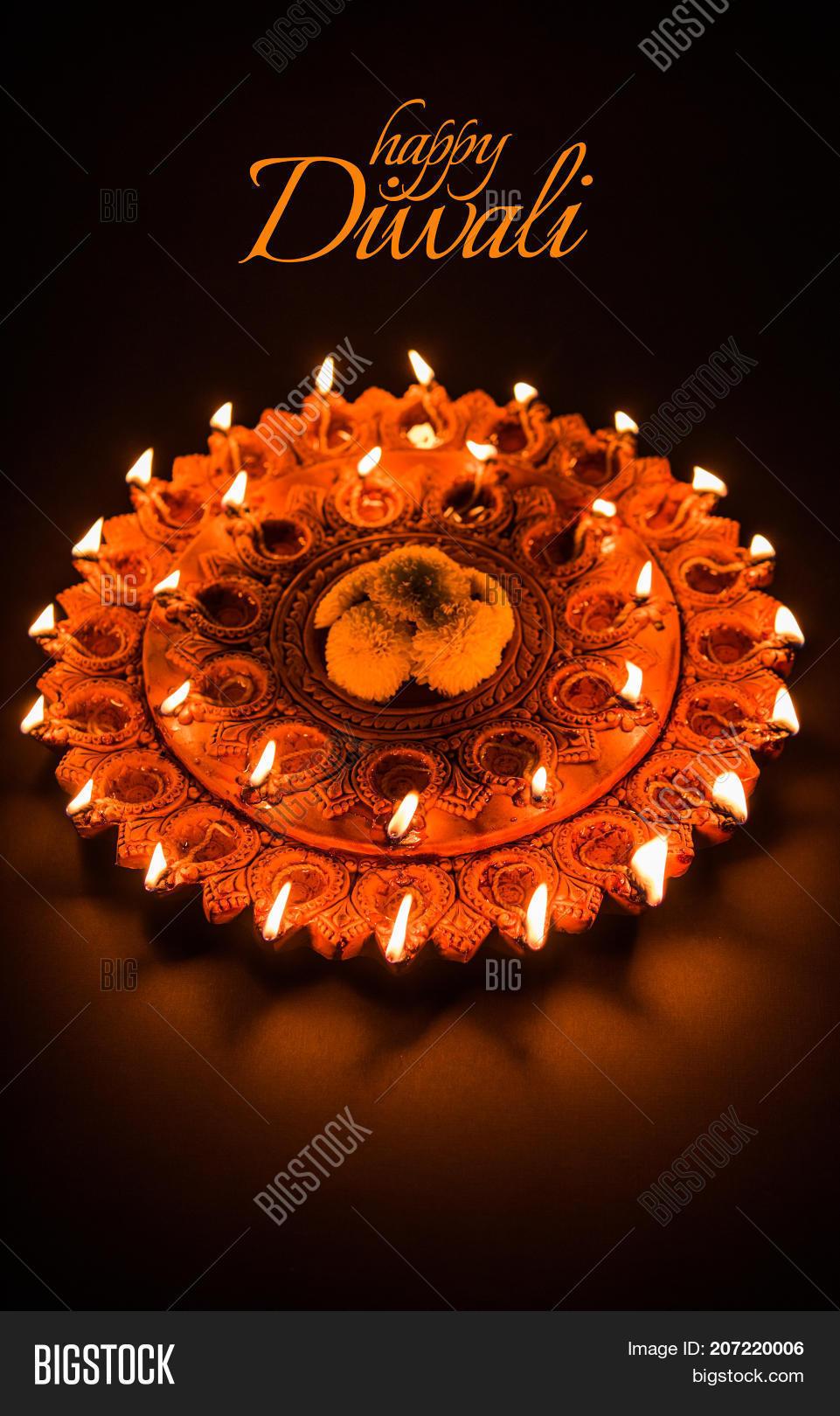 Happy diwali greeting image photo free trial bigstock happy diwali greeting card design using beautiful clay diya lamps lit on diwali night celebration m4hsunfo