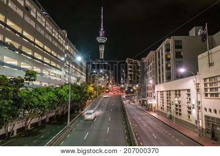 Night time cityscape of Hobson Street near Viaduct Harbour Auckland New Zealand NZ - empty streets with moving taxis