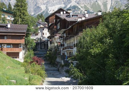 Typical view of mountain river and typical building of Cortina d'Ampezzo Veneto Italy.