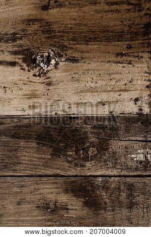 Texture of old wooden boards of dark brown colors