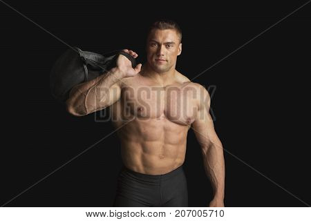 Strong Bodybuilder With Six Pack on Black on Black Background