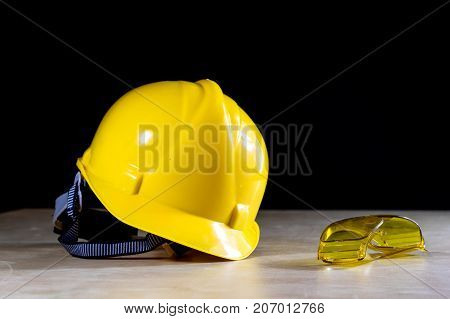 Workwear, Helmet, Gloves And Glasses On A Wooden Working Table. Place Workshop.