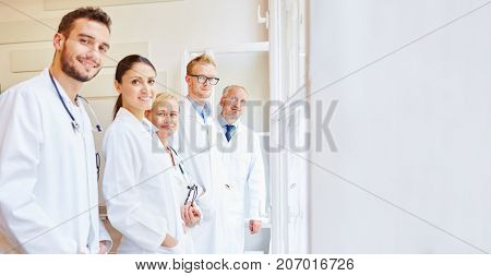 Team of doctors at hospital with medical specialists and assistants