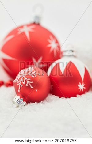 Merry christmas with christmas balls as background