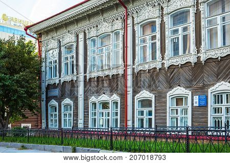 Novosibirsk Siberia Russia - 17 September 2017: apartment house burghers M.N. Pyatkova a monument of wooden architecture (built in early 1905) Communist street 23