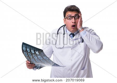 Young male doctor holding a radiograph isolated on white backgro