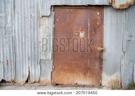 Old galvanized sheet with door texture background