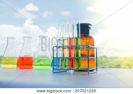 Laboratory glassware with colorful liquids for chemical experimental in laboratory analysis research science background