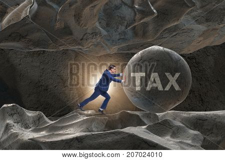 Businessman in high taxes business concept