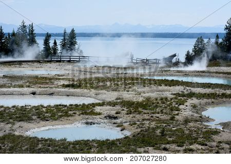 These hot springs are steaming from the super-volcano that is Yellowstone.  They flow into Yellowstone Lake and are ever-changing.  Due to Yellowstone being an active volcano, these springs can emerge anywhere at anytime.