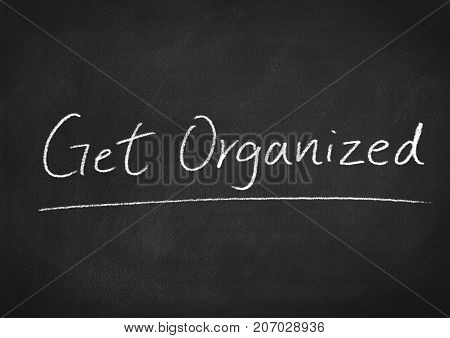 get organized concept words on a blackboard background