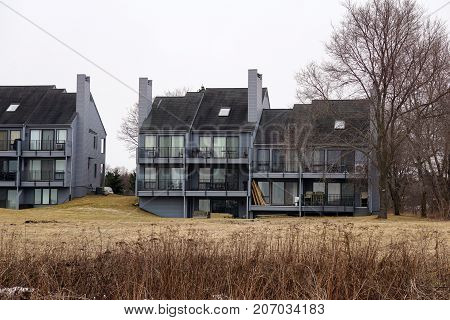 The Tannery Creek Condominiums stand beside the Little Traverse Wheelway, along the shore of Little Traverse Bay, near the Petoskey State Park, in Michigan. poster