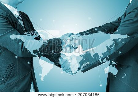 Double exposure of handshake with blur city night and network connection concept