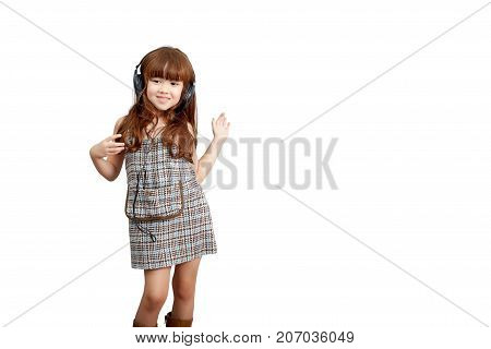 Music passion lifestyle concept : Happy little cute girl in headphones listening to music and dancing isolated on white background with clipping path. Cute mixed race Asia Europe girl 5 years old