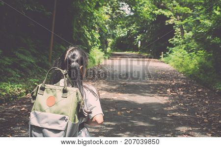 Girl With Backpack Hiking To The Hill.