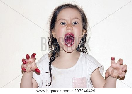 A little girl with bloody hands and a mouth. Horror. Mental disorders of children and adolescents