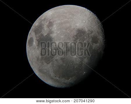 moon viewed through an 8 inch reflector amateur astronomer telescope