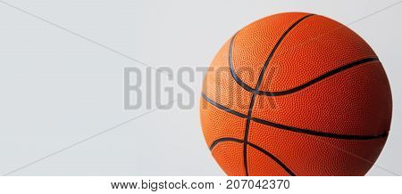 Sport and recreation basketball on gray background.