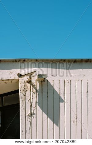 Schoolyard CCTV closed circuit camera for protection and surveillance with blue sky as blank copy space