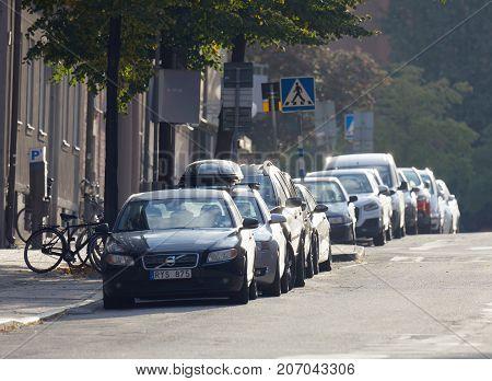 STOCKHOLM SWEDEN - OCT 01 2017: Parked cars on the street in morning light. October 01 2017 in Stockholm Sweden