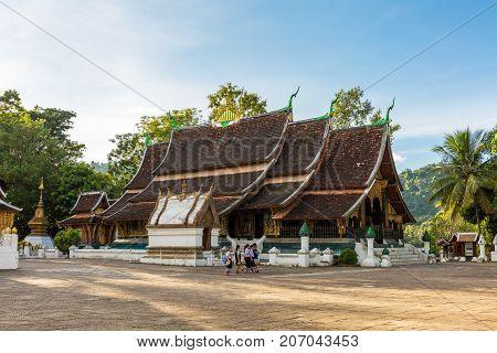 LUANG PRABANG LAOS - 9/21/2017: School children at Wat Xieng Thong a Buddhist temple in Luang Prabang Laos