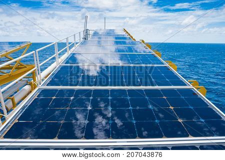 Solar cells at flare bridge at oil and gas wellhead remote platform for charging battery of electrical system on platform.