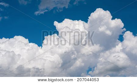 Blue sky with white clouds. The picture aspect ratio is 16: 9