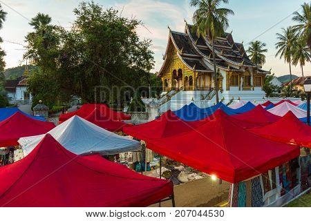 Luang Prabang Night Market And Haw Pha Bang Temple In Laos