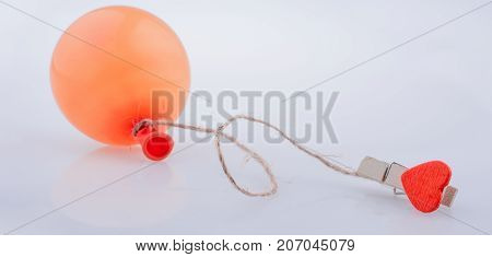 Heart Tied To A Baloon With A String