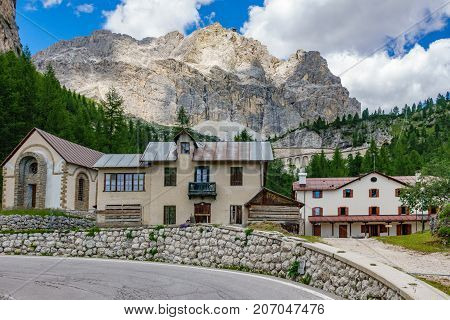 Wide angle view of curve with refuge Falzarego pass, Dolomite Alps, Italy