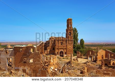 a view of the remains of the old town of Belchite, Spain, destroyed during the Spanish Civil War and abandoned from then, highlighting the San Martin de Tours church