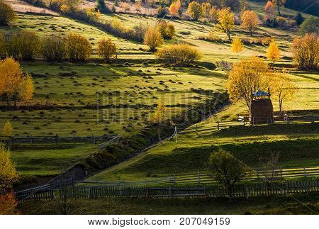 Haystack Near The Path On Hillside In Autumn