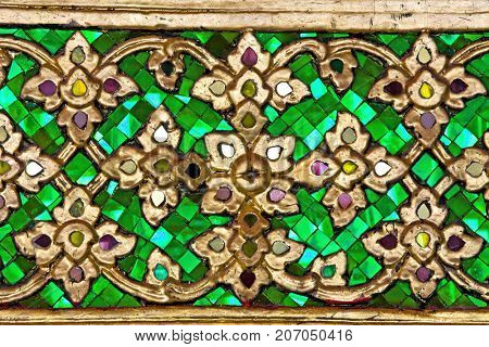 Pattern of green Thai Traditional Ornament on Temple door