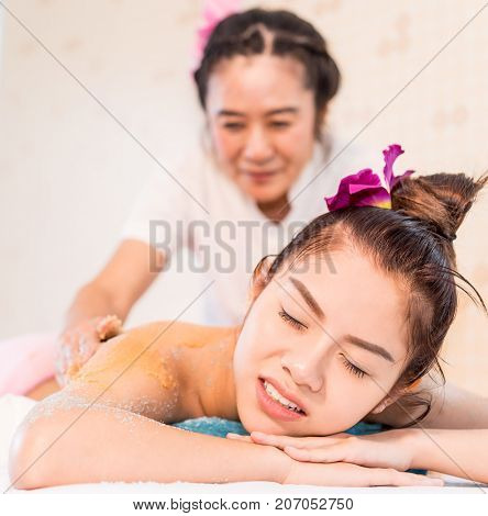 Asian women is getting hurt while recieving Spa massage