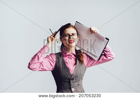 dissatisfied girl with glasses holds on to her head, isolated