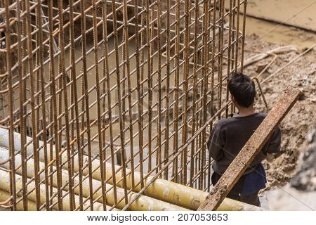 no safety worker danger at metal wire workplace with care of labor problem concept