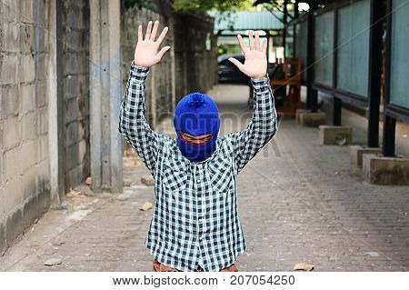 Masked thief stop and raising hands up. Catch burglar concept