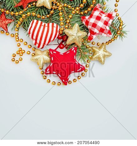 Christmas Background with Xmas Tree Twig Glitter Golden Stars Garland and Xmas Decor