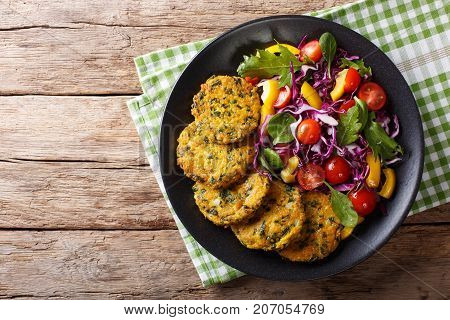 Diet Food: Quinoa Burgers With Spinach And Fresh Vegetable Salad Close-up. Horizontal Top View