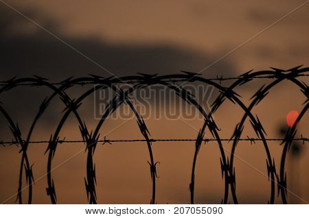 Fence with barbed wire. Barrier entry ban