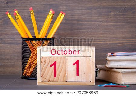 October 11. close-up wooden calendar. Time planning and business background.