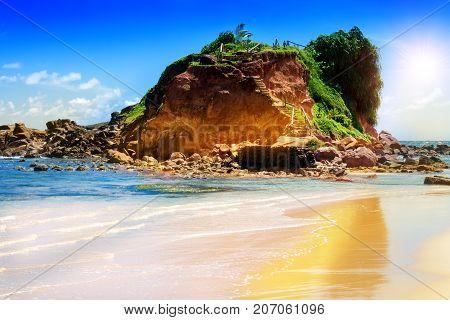 Ocean steep coast of the island and the blue sky.