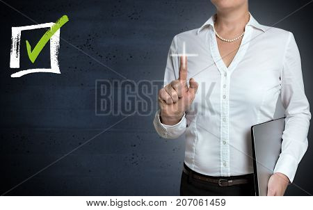 Checkbox touchscreen is shown by businesswoman picture