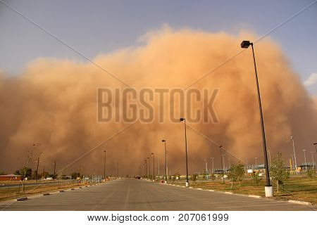 Large Dust Storm Blowing Toward Town with Wall of Dirt