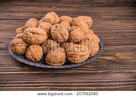 walnuts nuts in bag on wooden backgroun