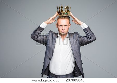Business King. Confident Businessman In Crown Standing Isolated On Gray
