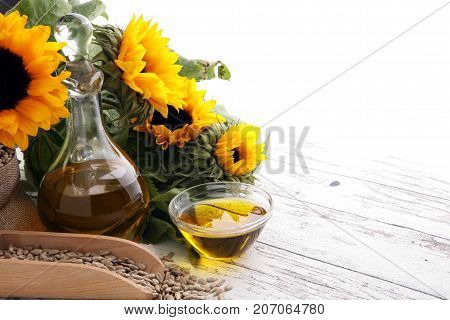 Sunflower Oil, Sunflower And Seeds On White Background