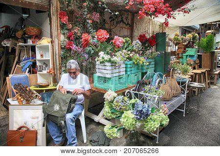 TEL AVIV, ISRAEL - APRIL 5, 2016:Man vintage furniture and other staff at entry to shop at Jaffa flea market district in Tel Aviv-Jaffa, Israel.